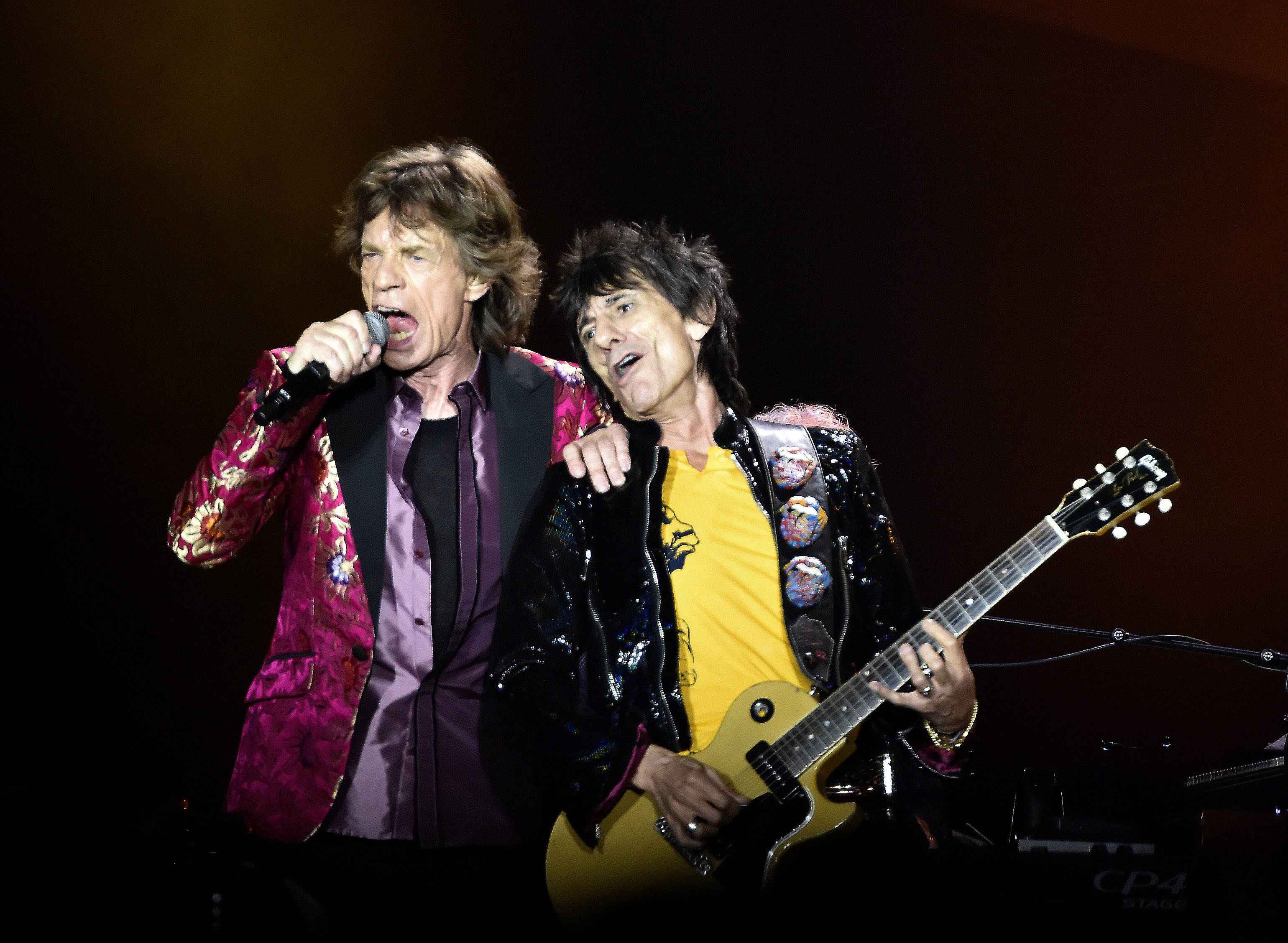 The Rolling Stones' Mick Jagger and Ronnie Wood perform on stage at the Citrus Bowl in Orlando, Florida, June 12,  2015. This is one of 15 stops in the Stones 2015 North American stadium tour. Band members are Mick Jagger,  Keith Richards,  Charlie Watts, and Ronnie Wood.    Photo by Gary I Rothstein /UPI / eyevine Contact eyevine for more information about using this image: T: +44 (0) 20 8709 8709 E: info@eyevine.com http://www.eyevine.com *** Local Caption *** 01552468